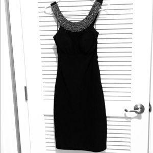 Beautiful classy black dress.